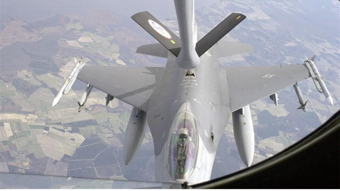 Image of KC-135 air refueling tanker providing fuel to a F-16 fighter plane