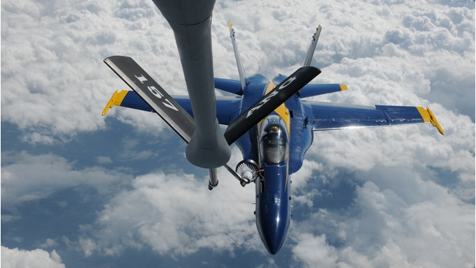 Image of U.S. Navy Blue Angels F-18 fighter airplane being refueled by a KC-135 air refueling tanker