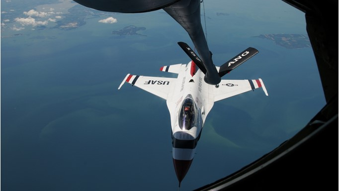 Image of U.S. Air Force Thunderbird F-16 fighter airplane being refueled by a KC-135 air refueling tanker